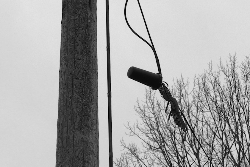 Telephone pole with broken line and connection point loose from its mount [photo: Henrik Hemrin]